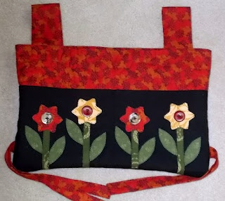 This is a walker bag I just made based upon a free pattern I found on the web:  http://sewing.about.com/od/healthbeautyitems/ss/walkerbag.htm