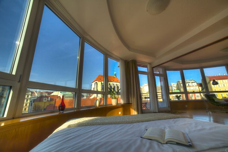 A room with a view indeed… visit Prague and stay in this beautiful modern apartment! http://en.svoboda-williams.com/short-term-rentals/apartment/102-glass-suite-apartment/