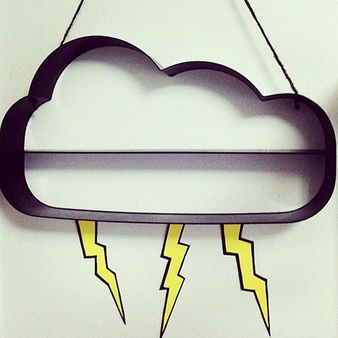 Spray-paint this cool Kmart cloud shelf black (from it's original blue hue) to make it really stand out. Then add lightning for a superhero themed room!