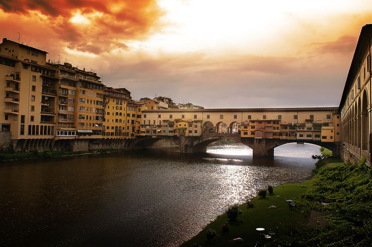 A sunset with some clouds above Ponte Vecchio in Florence