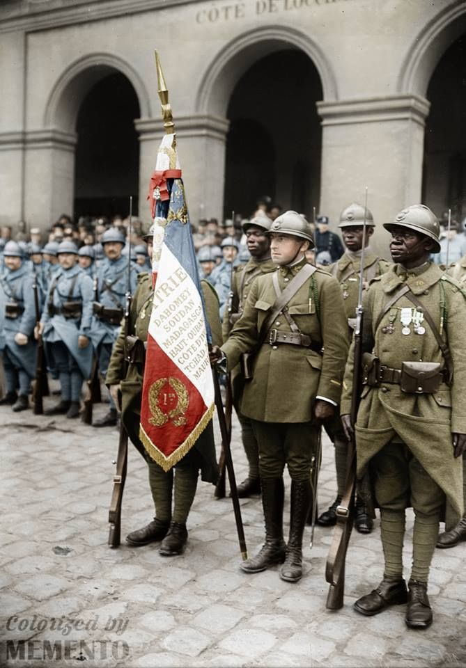 """16 May 1919, Invalides - Court of Honour, The military medal is awarded to the 1st Senegalese Tirailleurs Regiment (1er RTS)  In 1913, the Minister of War, Eugène Etienne, declared : """"In recognition of the merits of these glorious and valiant troops, I have the honor to propose that you confer the insignia of the Legion of Honor to the flag of the 1st Regiment of Tirailleurs, their most ancient regiment. """" ((the Legion of Honour is the highest French order for military and civil merits)"""