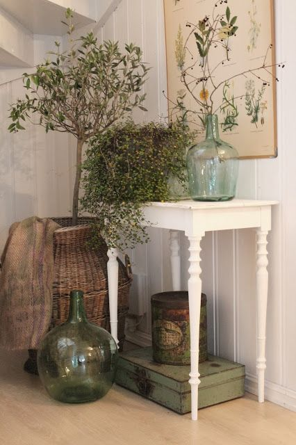 love the colors are consistent, the textures of the plants with the plant print.. the glass jars and the metals.. plus a burlap (or something) throw with hints of green