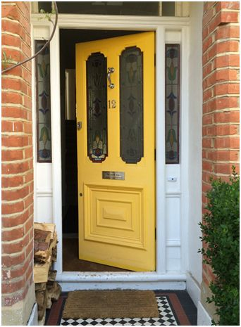 yellow front door with stained glass