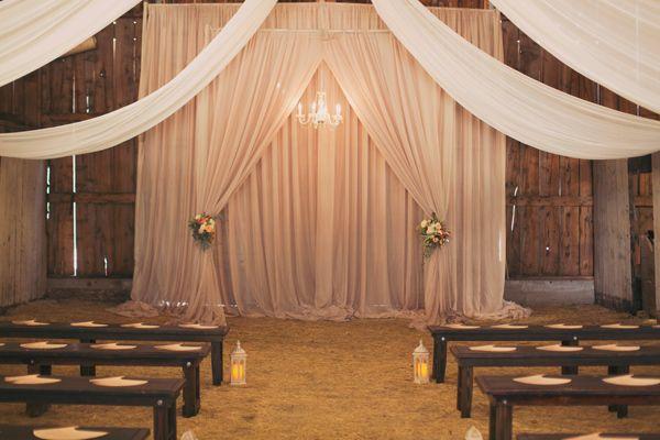 indoor barn ceremonies - photo by Alixann Loosle http://ruffledblog.com/blush-and-gold-utah-wedding