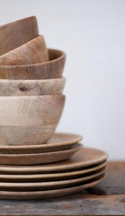 "Wooden bowls...""Why not have wooden dishes? They are lightweight, nearly impossible to break and add a wonderful organic warmth to the table. Plus, they would look great stacked up on open shelves!"""