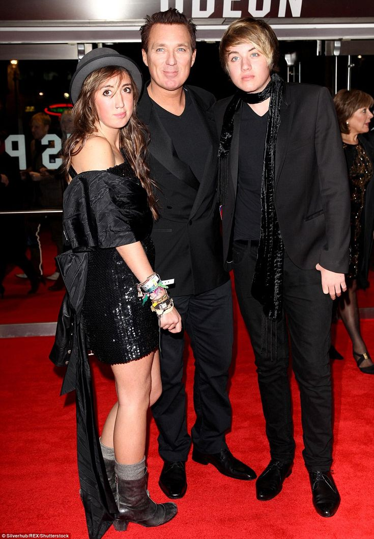 George Michael was Godfather to Martin Kemp's children Harley Moon and Roman, pictured with their father in 2009
