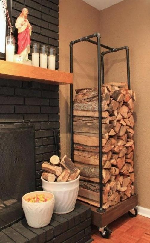 Pipe and wood make a firewood storage system, great to put in the garage near the firewood box for restocking