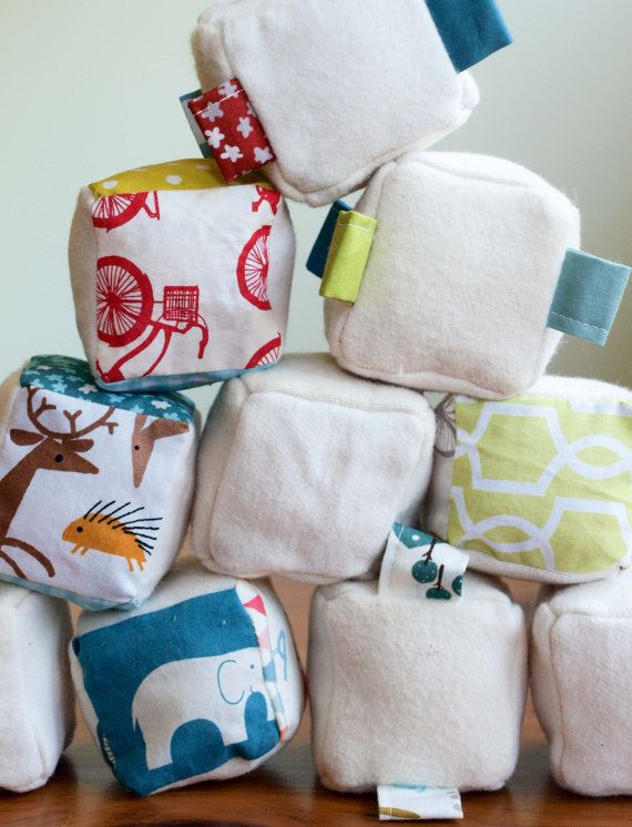 Sure to be the super-stars of your baby's toy box, our set of three organic cotton soft blocks are crafted for hours of natural, tactile fun!Carefully handcrafted in Canada and stitched from the softest US-grown, certified-organic cotton flannel and colorful organic cotton prints, our sweet soft blocks are individually stuffed with eco-friendly, naturally anti-bacterial, Canadian wool and come nestled in their own sweet organic cotton bag.