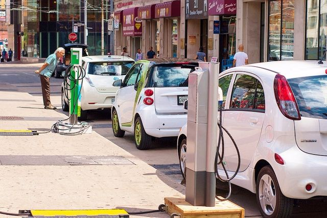 17 states seeking to boost their infrastructure funding have opted to add fees for electric car owners. (Electric cars charging on Ontario, Canada, street via EVObsession)