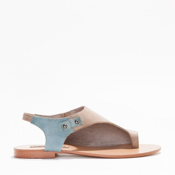 A two-tone full leather half cover women's sandal with a resin outsole for longer wear. A high quality minimal classic design leather lined best selling shoe.