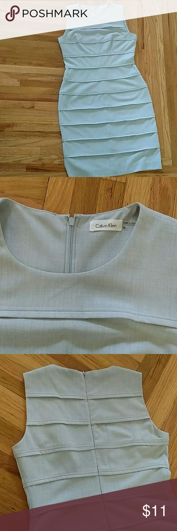 """Calvin Klein Light Blue Dress Size 10 Well Made Fitted Dress hugs your curves and stretches for comfort. Packs easily and no signs of wear. Thick forgiving synthetic fabric. Very flattering on. I am 5'9"""" and it hits just above the knees. Willing to bundle. Calvin Klein Dresses Midi"""