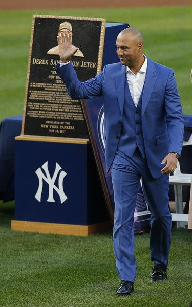 Derek Jeter Photos Photos - Former New York Yankees great Derek Jeter stands by his plaque during a pregame ceremony honoring Jeter and retiring his number 2 at Yankee Stadium on May 14, 2017 in New York City. - Derek Jeter Ceremony