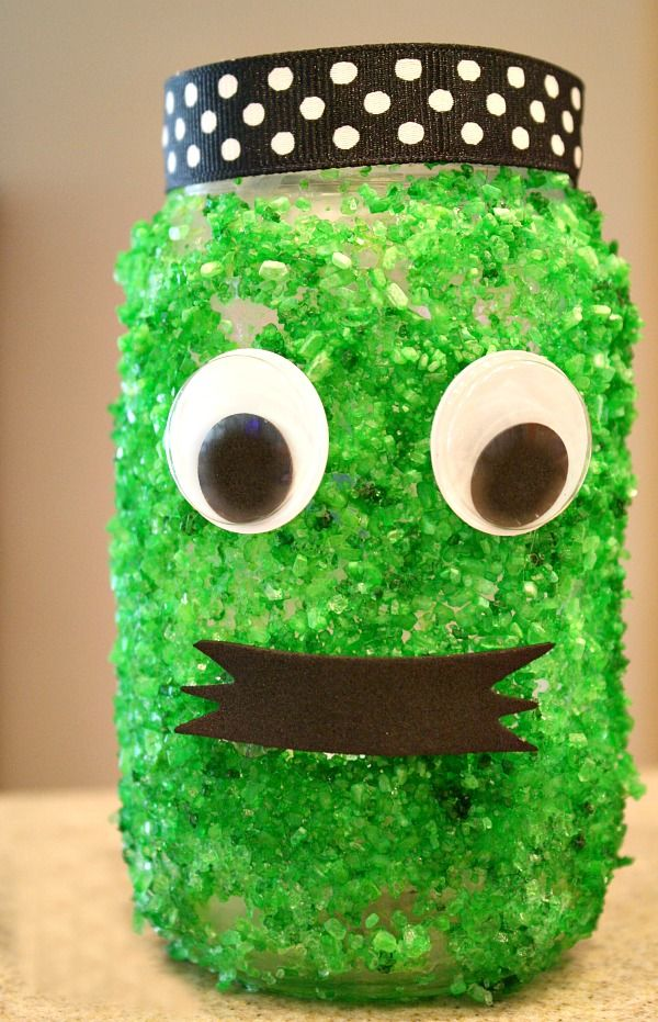 Not So Scary Green Monster Halloween Luminary...use recycled jars and a few inexpensive materials to make this Halloween craft for kids