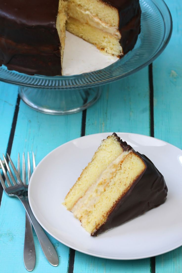 Boston Cream Pie Cake made completely from scratch with indulgent pastry cream, fluffy yellow cake, and rich chocolate ganache. Treat yo'self!