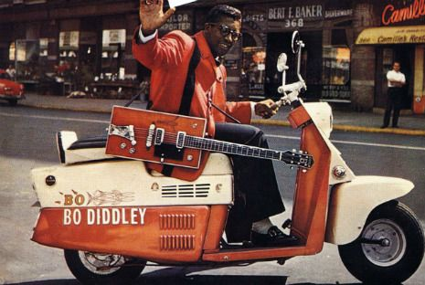 Bo Diddley on a customized scooter.