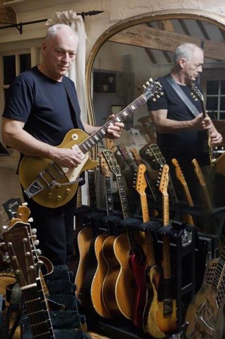 "Pink Floyd ""Money Makers"" Legendary guitarist ""David Gilmour poses with his treasured vintage 1956 Gibson LP Gold Top / Bigsby. Ready to rock and roll beside him, awaits Gilmour's fully-loaded Arsenal!"""
