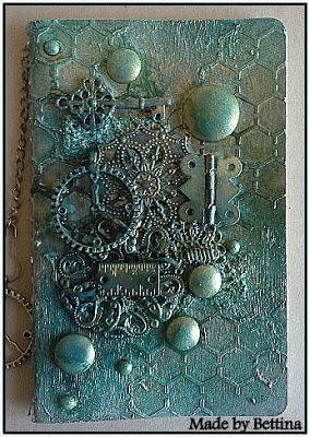 Scrap-Unlimited. paper mache and three colors of ink sprays, embossing powder and ink gold.