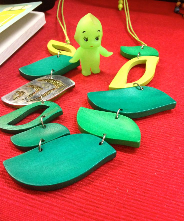 Green timber leaves necklace with metal highlight... the kewpie doll loves it!