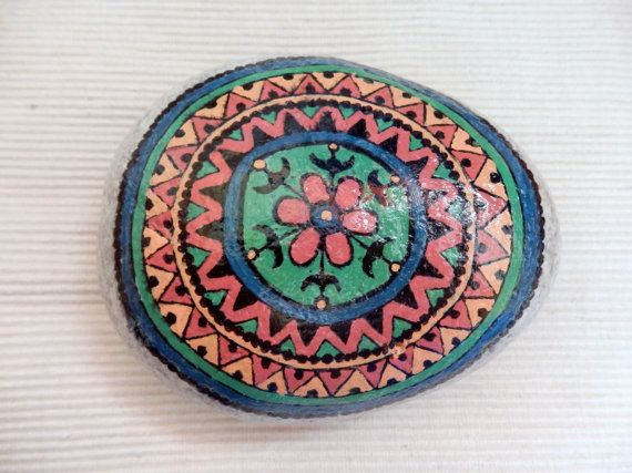 Handpainted mandala on a stone, collected from Psaropouli beach in Evia, Greece, with acrylic paints and a glossy lacquer.  It can be used for