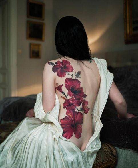 Awesome red hibiscuses tattoo