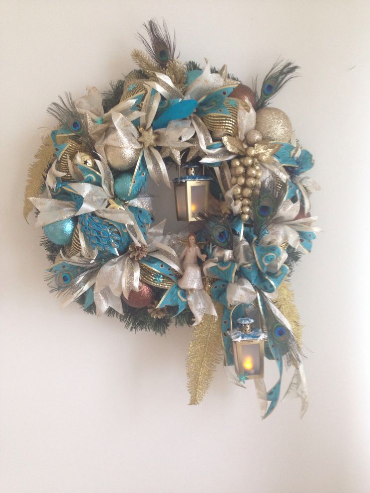 Peacock Wreath. Christmas gold peacock wreath. Added ribbon strips and bow. Added golden leaves and grapevine, pinecones, christmas ornaments, two decorated lanterns, angel, peacock and peacock feathers.  More at https://www.facebook.com/Moje-vence-995508700482994/