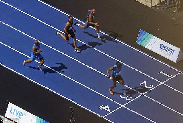 Usain Bolt speeds to 100m victory on Copacabana be...