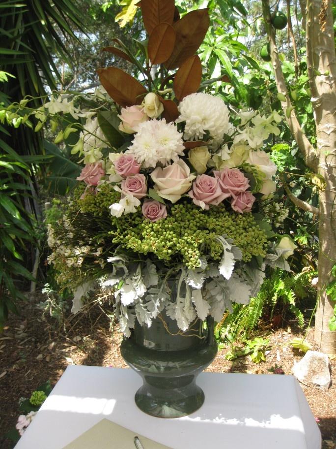 wedding picture board ideas - Gorgeous flower urn in garden