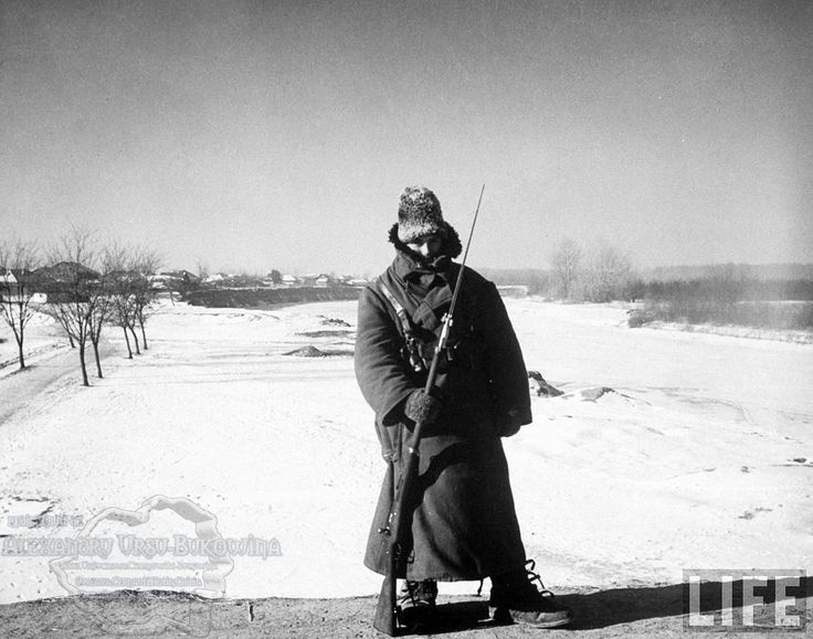 49.Tighina.Rumanian Army guard clad in cold weather gear, during sentry duty on the bridge over the frozen Prut River in 35 degree-below-zero weather which makes it impossible for him to be on more than an hour at a time.