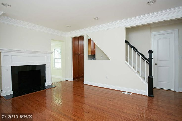fire place and black and white stair rail
