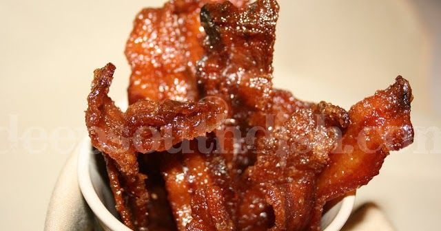 Candied Bacon, glazed with a spicy brown sugar seasoning and baked. Pig Candy!