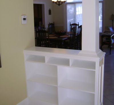 Half wall with shelf living room pinterest shelves columns and foyers - Half wall bookcase room divider ...