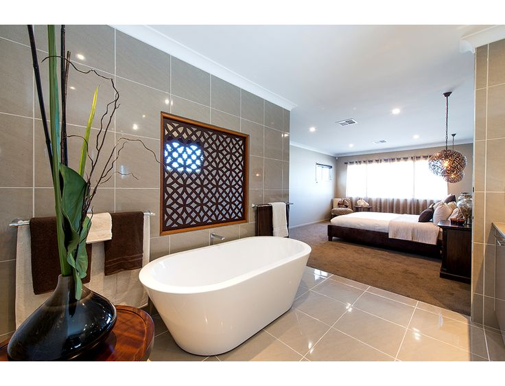 We love the open plan design of this bedroom and bathroom.