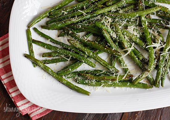 Roasted Parmesan Green Beans  Skinnytaste.com  Servings: 4 • Serving Size: 1 cup • Old Points: 1 pts • Points+: 2 pts  Calories: 62.4 • Fat: 2.9 g • Carbs: 8.0 • Fiber: 3.8 • Protein: 2.7 g • Sugar: 0  Sodium: 38.4 mg (without salt)    Ingredients:        12 oz green beans, trimmed (make sure they are dry)      2 tsp olive oil      kosher salt + fresh cracked pepper to taste      1/4 tsp garlic powder      1 1/2 tbsp shredded parmesan