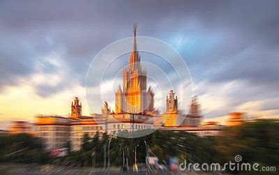 Radial blurred view of sunset Moscow university under cloudy sky