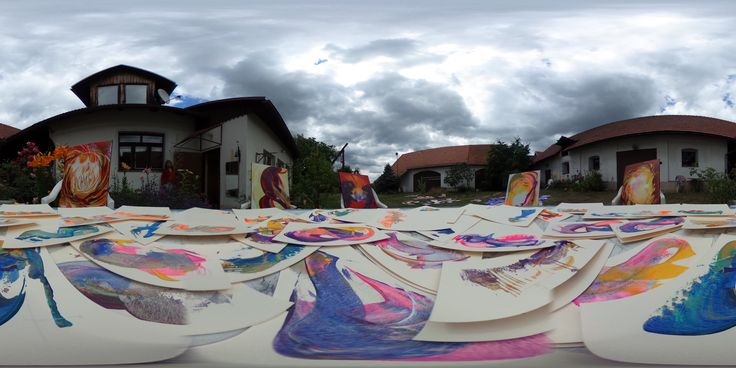 The yard of my house is covered with my energetic painintings. The colours and the clouds are mooving in expresive harmony!