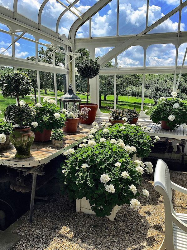 Carolyne Roehm Weatherstone greenhouse~ Someone, please straighten the table leg.