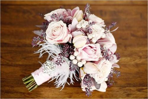 Love the subtle colors in this bridal bouquet and feathers to boot!