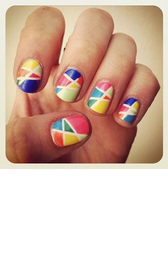 paint nails white, let dry, then just stick thinly cut strips of scotch tape and paint each section a different color