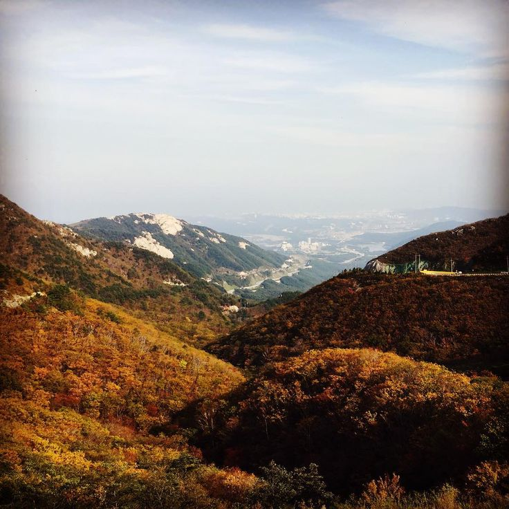 View from the top of Misiryeong Ridge, the valley and Sokcho and the East Sea in the background. #Misiryeong #MisiryeongRidge #미시령