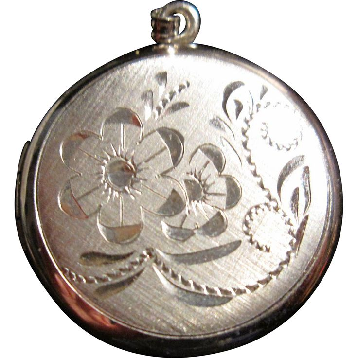 Vintage Sterling Locket Floral Design.   https://www.pinterest.com/clarasjewelry/christmas-on-ruby-lane/