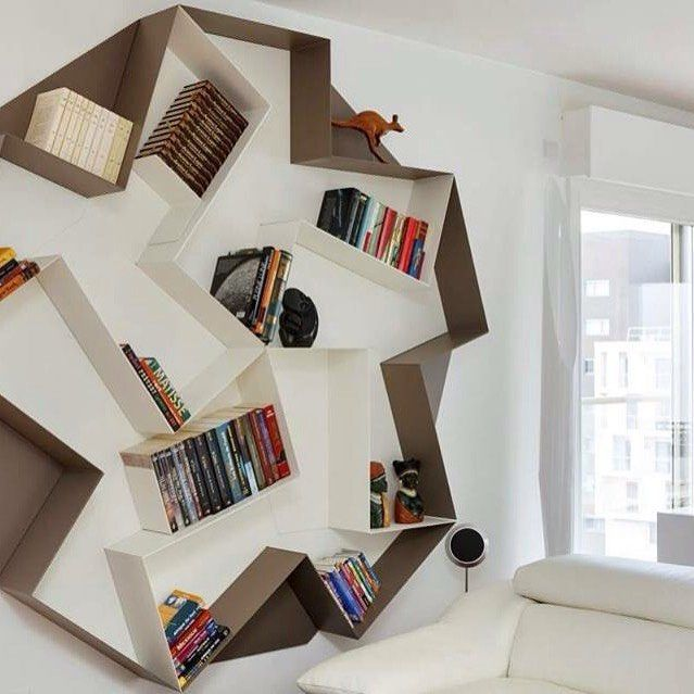 Slide shelf organizes with style. #lagodesign #interiordesign #shelf
