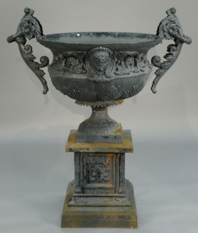 Victorian iron urn with large foliate arms and wreath rings with sheep face on either side on pedestal ~ Realized Price $3,250.00 #nadeausauction