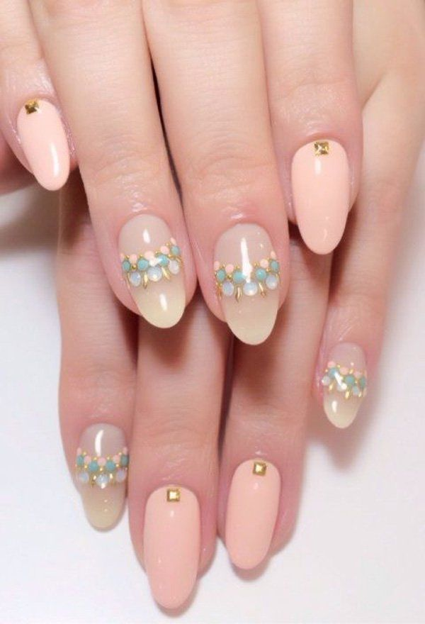 Beads all the way! These nails talk fashion! If you want to stand out from the crowd go ahead with this nail art look. Partner baby colored beads on your nails with a combination of nude and melon shades of acrylic paint plus golden beads. Pull up some hip outfits and you're picture perfect!