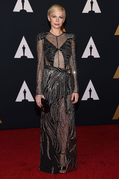 Michelle Williams looks festive in a metallic dress from Louis Vuitton. More celebrity style inspiration here: http://www.harpersbazaar.co.uk/fashion/style-files/news/g37370/best-dressed-this-week-14-november/