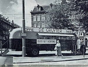 1960. De Gruyter bus at the Van Limburg Stirumplein in Amsterdam. De Gruyter was a grocery store chain operating across the Netherlands in the 19th century and 20th century (until 1976). At the peak the company employed more than 550 shops and almost 7,500 employees. The downturn came when De Gruyter in the 1960's not quick enough transitioned to the modern supermarket model. #amsterdam #1960 #DeGruyter #VanLimburgStirumplein