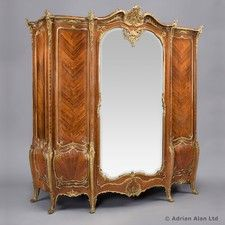 An Exceptional Gilt-Bronze Mounted Kingwood and Marquetry Armoire