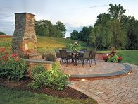 You can enjoy dining al fresco year round with this striking fireplace patio made of Cast Veneer Stone.  www.ephenry.com