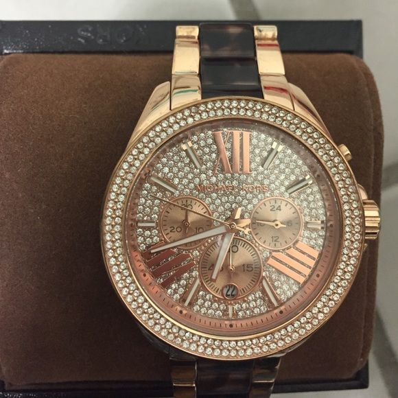 Michael kors watch never worn crystals Brand new Michael kors watch. Only took the links out and I have the links. Super sparkly. Definitely a statement piece Michael Kors Accessories Watches
