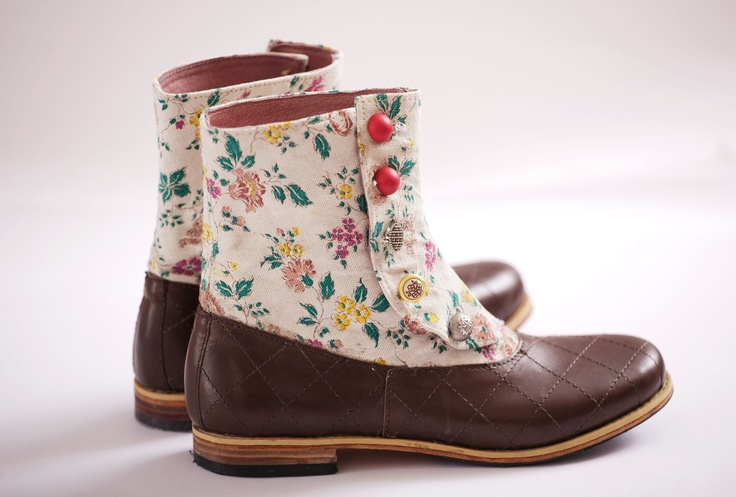 This buttoned up brand new boots made of leather and recycled vintage textile and decorated with plaid stiches and collected buttons.