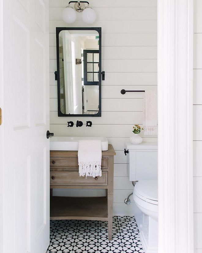 shiplap wall, cement floor tile and whitewashed white oak vanity. The designer ordered the vanity from Noir Furniture and outfitted for the sink on top, and plumbing below.